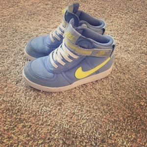 Blue and yellow Nike's